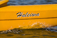 Outrigger canoe with Haleiwa written on bow, North Shore of Oahu
