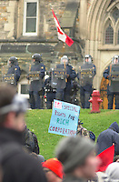 OTTAWA , November 17th 2001 FILE PHOTO<br /> <br /> Demonstrators walk on Wellington Street toward the Supreme Court Building, while  Policemen in riot gear stand in front of the House of Commons Buliding, during the Summit of G-20 Countries in Ottawa on Saturday, November 17, 2001.<br /> <br />  Police  used tear gas, concussion grenade's and pepper spray in their attempt to repel the protestor's from entering the security perimeter.<br /> <br /> The  G-20 meeting , where central bank chiefs and finance ministers from rich and poor nations discuss topics such as ; terrorism funding, economy slowdown and 3rd world nation's debt was initially scheduled for september in India,but  postponed  to  November 16th to 18th, 2001 and is beeing hosted by G-20 Chair ;  Canada Minister of Finance ;  Paul Martin.<br /> <br /> (Photo by Pierre Roussel <br /> ON SPEC<br /> NOTE l Nikon D-1 jpeg opened with quimage icc profile, saved in Adobe 1998 RGB.