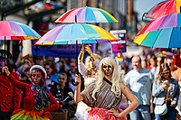 Pictured: Young people with rainbow coloured umbrellas take part in the Pride parade as it  travels through the streets of Swansea, Wales, UK. Saturday 05 May 2018<br /> Re: Spring Pride has brought a celebration of colour to the streets of Swansea in Wales, UK.<br /> Rainbow flags were flown in support of the LGBT community at the event, which is designed to raise awareness and is open to anyone to take part in.