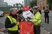 UNITE members blockade the entrance to the HS2 site in Euston in protest over a number of issues including anti union practices by employers Costain and Skanska and disputes over pay and overtime. London 4-10-19