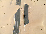 Desert roads covered by sand by Iwona Deren