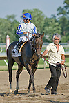 20 JUN 2010: Alan Garcia glances back at the tote board waiting for the Monmouth Park stewards decision.