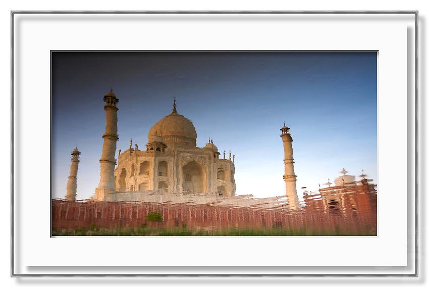 The Taj Mahal reflecting in the Yamuna River, India