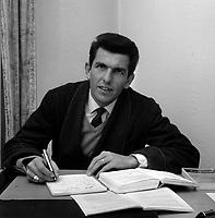 9 Janvier 1964. Vue de Jean Fabre, joueur du Stade Toulousain, travaillant sur son bureau à son domicile.<br /> <br /> Jean Paul Gabriel Fabre, né le 7 novembre 1935 à Rodez1, est un ancien joueur de rugby à XV français, occupant le poste de troisième ligne aile au Stade toulousain durant les années 1960.