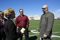 MLB pitcher and PLHS Alumi David Wells speaks with principal Bobbie Samilson (L) before  a Memorial service held for Coach Bennie Eden at the Point Loma High School Football stadium that was recently renamed in his honor, Saturday February 23 2008.