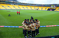 The Black Caps huddle before the third international men's T20 cricket match between the New Zealand Black Capss and Australia at Sky Stadium in Wellington, New Zealand on Wednesday, 3 March 2021. Photo: Dave Lintott / lintottphoto.co.nz