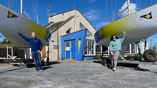 David Kelly Jnr, Sailing Secretary (left) and Lauren O'Hare, committee member and Senior Instructor with the newly refurbished club J/24s at Rush Sailing Club