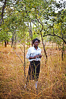 """15 year old Hellen Chola from Chalilo school in Sereje district, on her first safari in Kasanka National Park. """"A National Park is a place where trees and animals are protected. Even human beings are protected,"""" Helen says. """"I have never seen a wild animal - only domesticated animals like cattle, pigs and goats..If National Parks weren't here, all the trees and animals would be devastated."""" Local schools and women's groups are regularly brought into Kasanka, which is unique in the country and unusual in Africa as it is privately managed and owned by a trust. People are able to see animals flourishing in land which was once free reign for poachers. Combined with anti-poaching scouts, the education programme is on the frontline of conservation methods in the park, showing local people wild animals in their natural habitat."""
