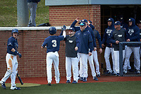 Carson Simpson (3) of the Wingate Bulldogs high fives his teammates after scoring a run against the cm\ at Ron Christopher Stadium on February 1, 2020 in Wingate, North Carolina. The Bulldogs defeated the Mountain Lions 8-0 in game one of a doubleheader. (Brian Westerholt/Four Seam Images)