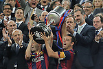 King Felipe VI of Spanin gives the cup to Barcelona´s Xavi Hernandez and Andres Iniesta after winning the 2014-15 Copa del Rey final match between Barcelona and Athletic de Bilbao at Camp Nou stadium in Barcelona, Spain. May 30, 2015. (ALTERPHOTOS/Victor Blanco)