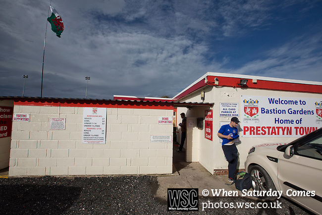 Prestatyn Town 0 Port Talbot Town 0, 19/10/2013. Bastion Gardens, Welsh Premier League. A spectator waiting beside the main entrance at Bastion Gardens prior to the match between Prestatyn Town and visitors Port Talbot Town in the Welsh Premier League. Prestatyn Town were Welsh Cup winners in 2013. The match ended goalless and was watched by 211 spectators. Photo by Colin McPherson.