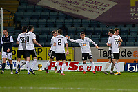 16th March 2021; Dens Park, Dundee, Scotland; Scottish Championship Football, Dundee FC versus Ayr United; Mark McKenzie of Ayr United is congratulated after scoring for 1-0