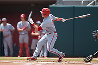 Brett Kinneman (6) of the North Carolina State Wolfpack follows through on his swing against the Northeastern Huskies at Doak Field at Dail Park on June 2, 2018 in Raleigh, North Carolina. The Wolfpack defeated the Huskies 9-2. (Brian Westerholt/Four Seam Images)