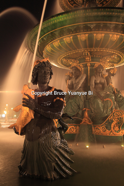 A closed up of night view of Fountain of River Commerce and Navigation in Place de la Concorde. Paris. France