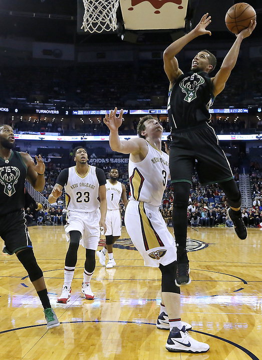 Milwaukee Bucks guard Michael Carter-Williams (5) shoots over New Orleans Pelicans center Omer Asik (3) during the first half of an NBA basketball game Saturday, Jan. 23, 2016, in New Orleans. (AP Photo/Jonathan Bachman)