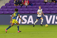 ORLANDO, FL - JANUARY 22: Emily Sonnett #14 looks for options as she is watched by Jorelyn Carabalí #16 during a game between Colombia and USWNT at Exploria stadium on January 22, 2021 in Orlando, Florida.