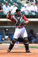 Birmingham Barons catcher Kevan Smith (32) during a game against the Tennessee Smokies on April 21, 2014 at Regions Field in Birmingham, Alabama.  Tennessee defeated Birmingham 10-5.  (Mike Janes/Four Seam Images)