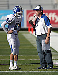 Carson's Matt Nolan talks with head coach Blair Roman during the NIAA 4A northern region football championship game between Reed High and Carson High on Saturday, Nov. 26, 2011, in Reno, Nev. Reed won 49-0 advancing to the state title game next Saturday against Bishop Gorman. .Photo by Cathleen Allison