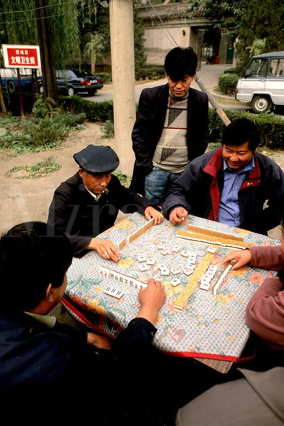 Men playing mah jongg in Beijing China