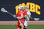Baltimore, MD - March 3:  Midfielder Brent Adams #8 of the Fairfield Stags fires on goal during the Fairfield v UMBC mens lacrosse game at UMBC Stadium on March 3, 2012 in Baltimore, MD.