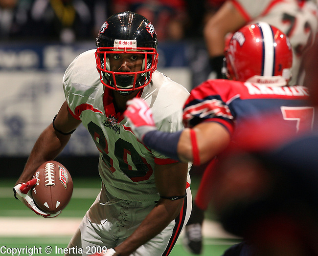 SIOUX FALLS, SD - APRIL 18:  James White #80 of the Sioux City Bandits looks to get past the defense of Kenneth Akridge #3 of the Sioux Falls Storm in the first quarter of their game Saturday night at the Sioux Falls Arena.(Photo by Dave Eggen/Inertia)