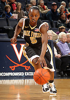 Feb. 3, 2011; Charlottesville, VA, USA; Wake Forest Demon Deacons guard Chelsea Douglas (5) handles the ball during the game against the Virginia Cavaliers at the John Paul Jones Arena.  Mandatory Credit: Andrew Shurtleff