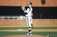 Quinnipiac Bobcats starting pitcher Taylor Luciani (18) looks to his catcher for the sign against the Radford Highlanders at David F. Couch Ballpark on March 4, 2017 in Winston-Salem, North Carolina. The Highlanders defeated the Bobcats 4-0. (Brian Westerholt/Four Seam Images)
