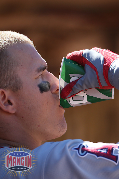 OAKLAND, CA - AUGUST 8:  Mike Trout of the Los Angeles Angels drinks Gatorade in the dugout during the game against the Oakland Athletics at O.co Coliseum on Wednesday, August 8, 2012 in Oakland, California. Photo by Brad Mangin