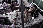 Kabul, Afghanistan<br /> November 23, 2001<br /> <br /> A sick child in the Indira Ghandi children's emergency ward of the hospital. The ward is funded by Save the Children.