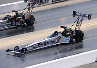 Sept. 15, 2012; Concord, NC, USA: NHRA top fuel dragster driver Antron Brown (near lane) races alongside Bob Vandergriff Jr during qualifying for the O'Reilly Auto Parts Nationals at zMax Dragway. Mandatory Credit: Mark J. Rebilas-