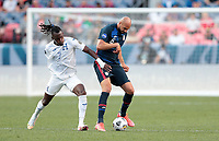 DENVER, CO - JUNE 3: Alberth Elis #7 of Honduras and John Brooks #6 of USA battle for a ball during a game between Honduras and USMNT at EMPOWER FIELD AT MILE HIGH on June 3, 2021 in Denver, Colorado.