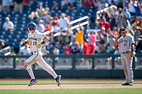Michigan Wolverines first baseman Jimmy Kerr (15) jogs around the bases after hitting a home run during Game 11 of the NCAA College World Series against the Texas Tech Red Raiders on June 21, 2019 at TD Ameritrade Park in Omaha, Nebraska. Michigan defeated Texas Tech 15-3 and is headed to the CWS Finals. (Andrew Woolley/Four Seam Images)