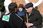 Anti-eviction activisttalk to a pedestrian elder matrimony during an 'escrache'  outside Bankia's headquarters at Plaza de Castilla Square in Madrid on April 11, 2013 in Madrid, Spain. The Mortgage Holders Platform (PAH) and other anti evictions organizations have been organizing 'escraches' for several weeks under the slogan 'There are lives at risk' to claim the vote for a Popular Legislative Initiative (ILP) to stop evictions and facilitate social rent, outside Popular Party deputies' houses and offices. 'Escraches' are a form of peaceful protest that were used in Argentine in 1995 to publically denounce pardoned members of the dictatorship for their crimes at their doorsteps(ALTERPHOTOS/Alconada)