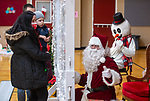 NAUGATUCK, CT-122120JS07- Roger and Angels Rua of Naugatuck, along with their son Enzo Rua, enjoy a visit with Santa, Frosty and Rudolph Monday at the Naugatuck Parks and Recreation Department. Residents can visit with Santa by appointment only through December 23 from 4 to 8 p.m. Admission is a non-perishable food item for the Naugatuck Ecumenical Food Bank, or a toy or gift card that will be donated to the United Way of Naugatuck and Beacon Falls' toy drive.  <br /> Jim Shannon Republican-American