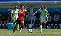 GRENOBLE, FRANCE - JUNE 12: Soyun Ji #10 of the Korean National Team dribbles as Ngozi Okobi #13 of the Nigerian National Team defends during a game between Korea Republic and Nigeria at Stade des Alpes on June 12, 2019 in Grenoble, France.