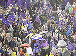 Southern Methodist Mustang and TCU Horned Frog fans watch the action during heavy rainfall in the game between the Southern Methodist Mustangs and the TCU Horned Frogs at the Gerald J. Ford Stadium in Dallas, Texas. TCU defeats SMU 24 to 16..