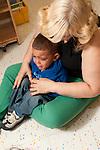Education preschool first days of school separation sald boy crying in teacher's lap age 2