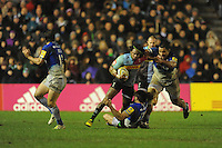 Marland Yarde of Harlequins charges through the tackle of Jamie George and Billy Vunipola of Saracens during the Premiership Rugby match between Harlequins and Saracens - 09/01/2016 - Twickenham Stoop, London<br /> Mandatory Credit: Rob Munro/Stewart Communications