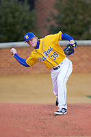 Delaware Blue Hens relief pitcher Luke Alicknavitch (39) warms up in the bullpen during the game against the Georgetown Hoyas at Wake Forest Baseball Park on February 13, 2015 in Winston-Salem, North Carolina.  The Blue Hens defeated the Hoyas 3-0.  (Brian Westerholt/Four Seam Images)