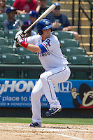 Round Rock Express third baseman Alex Buchholz (5) at bat against the Colorado Springs Sky Sox in the Pacific Coast League baseball game on May 19, 2013 at the Dell Diamond in Round Rock, Texas. Colorado Springs defeated Round Rock 3-1 in 10 innings. (Andrew Woolley/Four Seam Images).