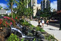 Landscaping with waterfalls and greeny along Kalakaua Avenue and Kuhio Beach, Waikiki, Honolulu, Hawaii