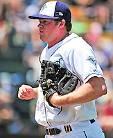 15 July 2010: Vermont Lake Monsters' pitcher Aaron Barrett trots back to the dugout during a game against the Aberdeen IronBirds at Centennial Field in Burlington, Vermont. The Lake Monsters rallied in the bottom of the 9th inning to defeat the IronBirds 7-6 notching their league leading 20th win of the 2010 NY Penn League season. Mandatory Credit: Ed Wolfstein Photo