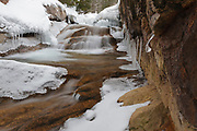 "The Baby Flume on the Pemigewasset River in Franconia Notch State Park in Lincoln, New Hampshire covered in snow. This water feature is located a short ways down river from the ""The Basin"" viewing area."