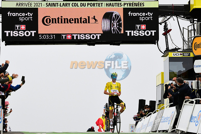 Yellow Jersey Tadej Pogacar (SLO) UAE Team Emirates crosses the finish line to win Stage 17 of the 2021 Tour de France, running 178.4km from Muret to Saint-Lary-Soulan Col du Portet, France. 14th July 2021.  <br /> Picture: A.S.O./Pauline Ballet | Cyclefile<br /> <br /> All photos usage must carry mandatory copyright credit (© Cyclefile | A.S.O./Pauline Ballet)