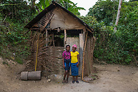 "Haiti, Gros-Morne. Christella Sigene Mercy Beyond Borders scholar and Constella, her mother, at their home in front of thier kitchen. ""With an education my daughter can have a better life, she can be a doctor or an engineer."""