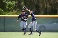 GCL Braves center fielder Sean Godfrey (64) catches a fly ball in front of left fielder Anthony Concepcion (38) backing up the play during a game against the GCL Pirates on August 10, 2016 at Pirate City in Bradenton, Florida.  GCL Braves defeated the GCL Pirates 5-1.  (Mike Janes/Four Seam Images)