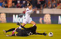 HOUSTON, TX - JANUARY 31: Christen Press #20 of the United States moves past Sasha Fabrega #12 GK of Panama during a game between Panama and USWNT at BBVA Stadium on January 31, 2020 in Houston, Texas.