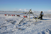 Wednesday March 14, 2007   ----   Norwegian Robert Sorlie mushes past a tripod marker as he approaches Nome to claim 13th place in the 2007 Iditarod.
