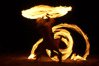 Two fire dancers performing on the beach