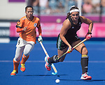 Wales Rose Hulme in action during todays event<br /> <br /> *This image must be credited to Ian Cook Sportingwales and can only be used in conjunction with this event only*<br /> <br /> 21st Commonwealth Games - Wales v Malaysia - Hockey-  Day 7 - 11\04\2018 - Gold Coast Hockey Centre - Gold Coast City - Australia